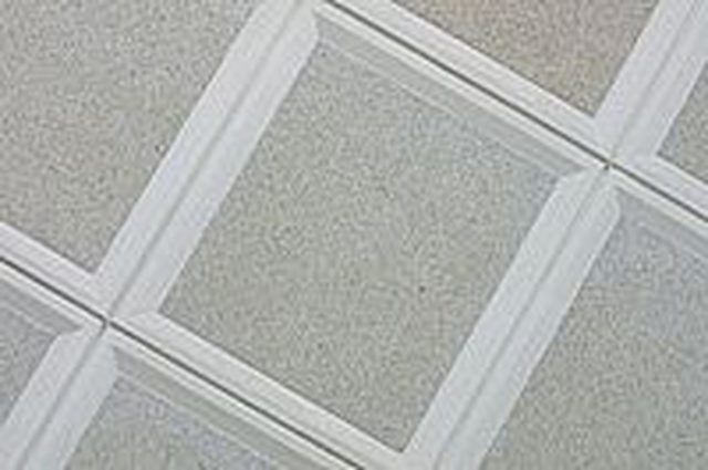 Ideas For Covering Up Old Ceiling Tiles Hunker Ceiling Tiles Ceiling Tiles Diy Ceiling Materials