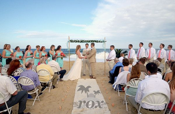 Rehoboth Beach Wedding Minister Sean Rox Officiates A Ceremony On The Sand Image By