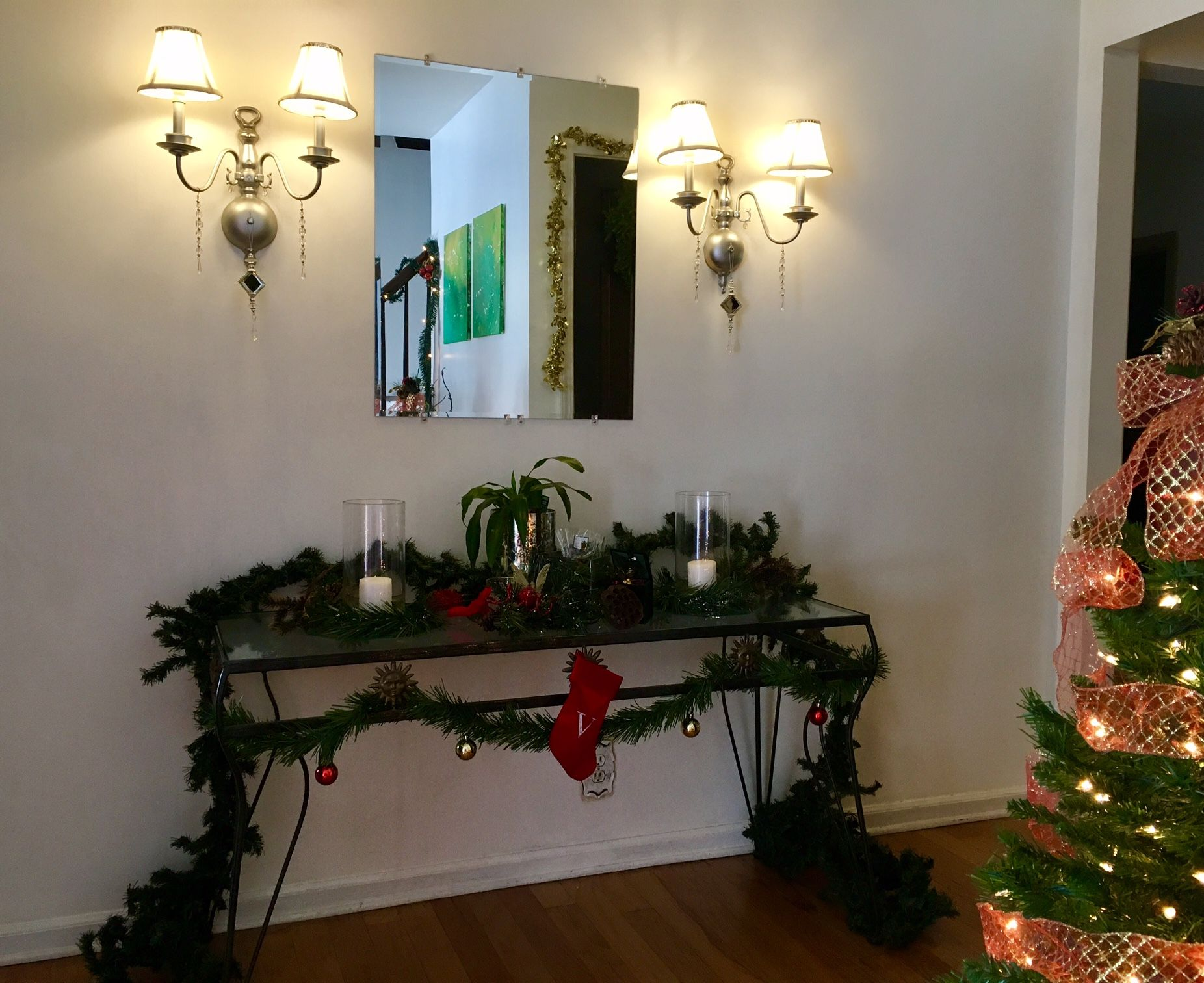 Our #foyer #sconces and #tablescape look gorgeous during the day as well. I love our #ministocking #monogrammed with a V for our #family name. ❤️🎄 #garland #stockings #christmasdecor #christmastime #christmas #holidaydecor #holidayseason