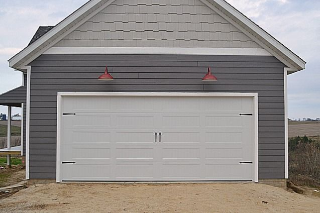A Carriage Garage Door And Red Barn Lights Barn Lighting Garage Doors Carriage Garage Doors