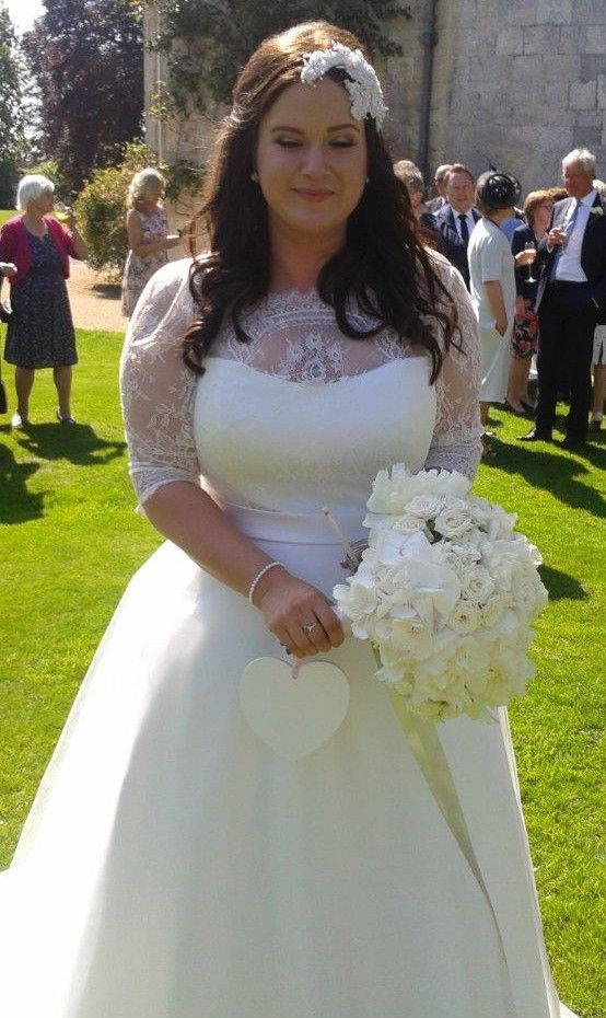 This Plus Size Wedding Gown Has A Sheer Illusion Neckline And Lace Sleeves Curvy Brides Can Have Slimmingbodyshapers