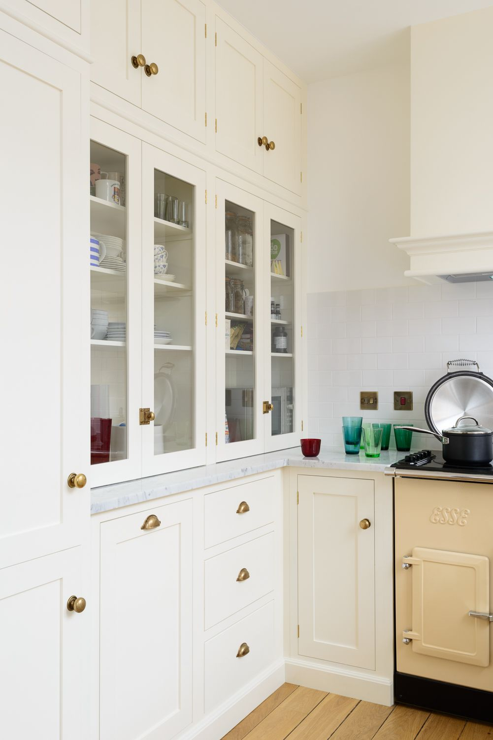 This beautiful wall of cabinets incorporates the fridge freezer and ...