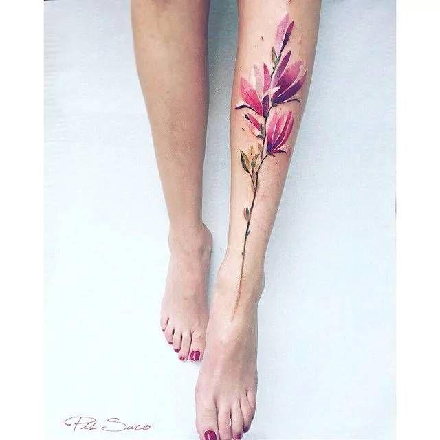 Magnolia tattoo on the left shin. Tattoo Artist: Pis Saro