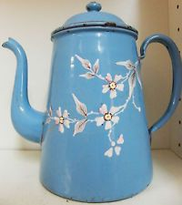 ENAMEL COFFEE POT, PALE BLUE WITH PAIBTED WHITE FLOWERS.