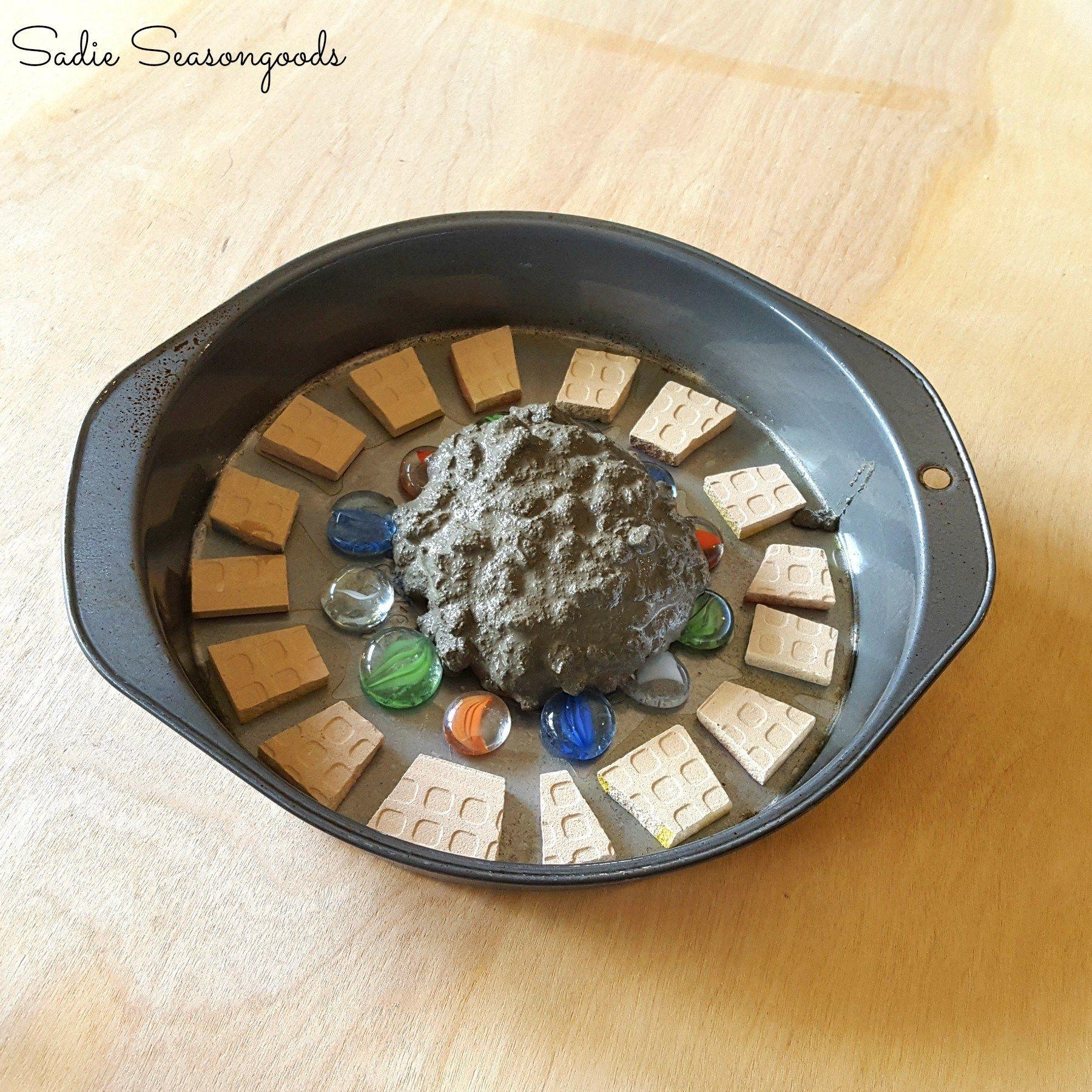Diy Stepping Stones Repurposed Thrift Store Cake Pan For Diy Concrete Mosaic Stepping