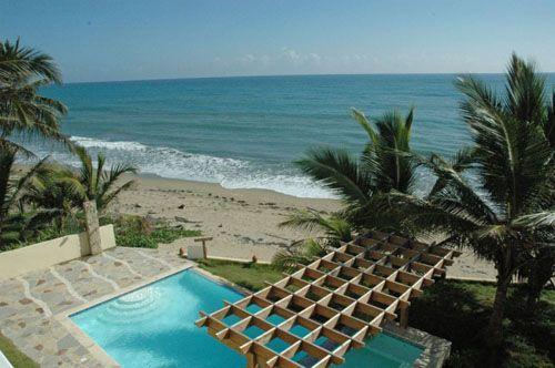 High Standard Beachfront Apartments Cabarete.. I could so see myself relaxing in this pool and sailing on this sea!
