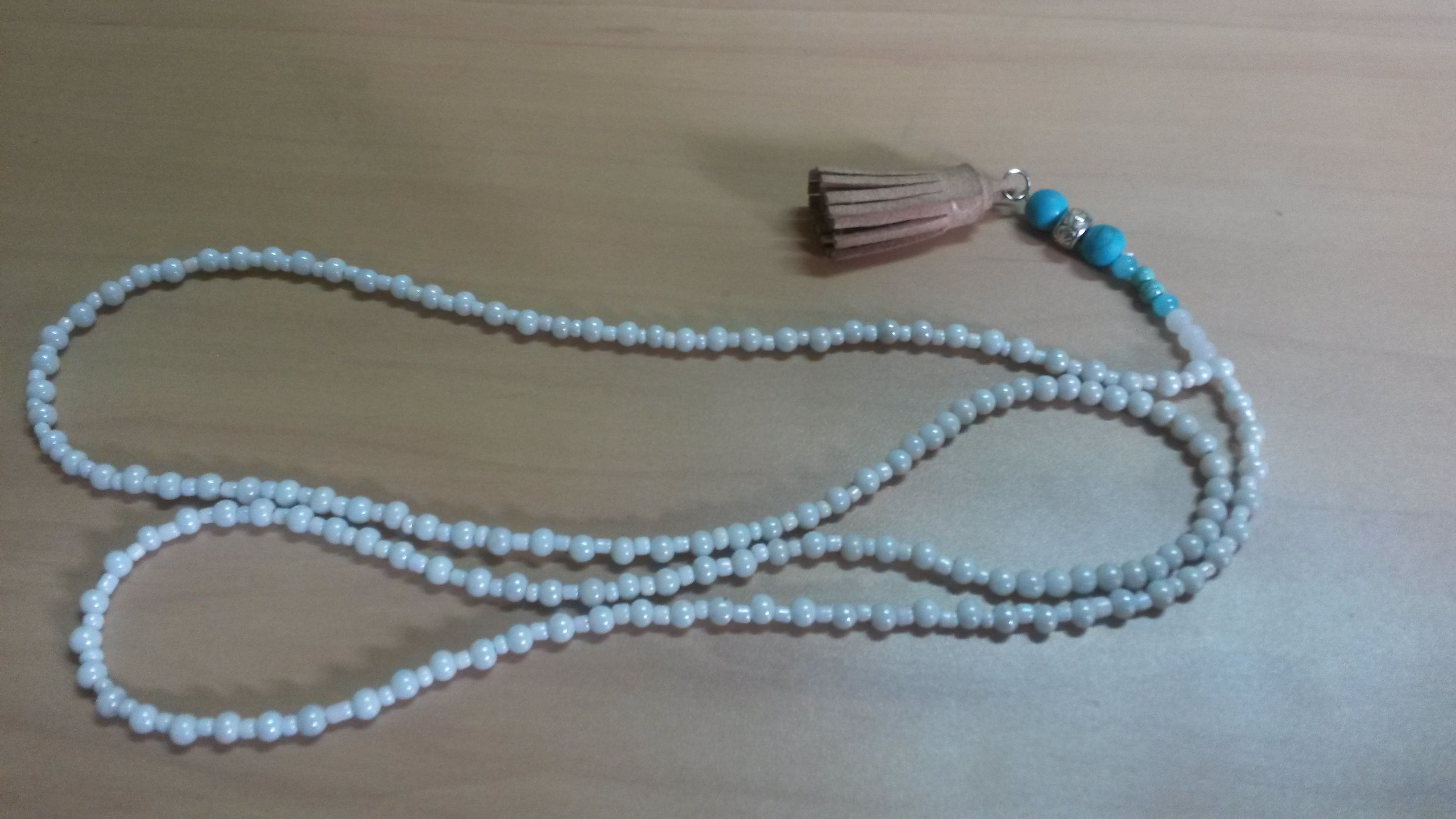 White and turquoise tassel necklace