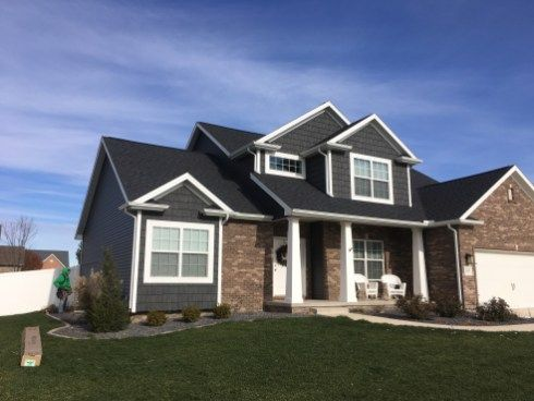 Dark Grey Siding With White Trim And Dark Roof Brown Brick And
