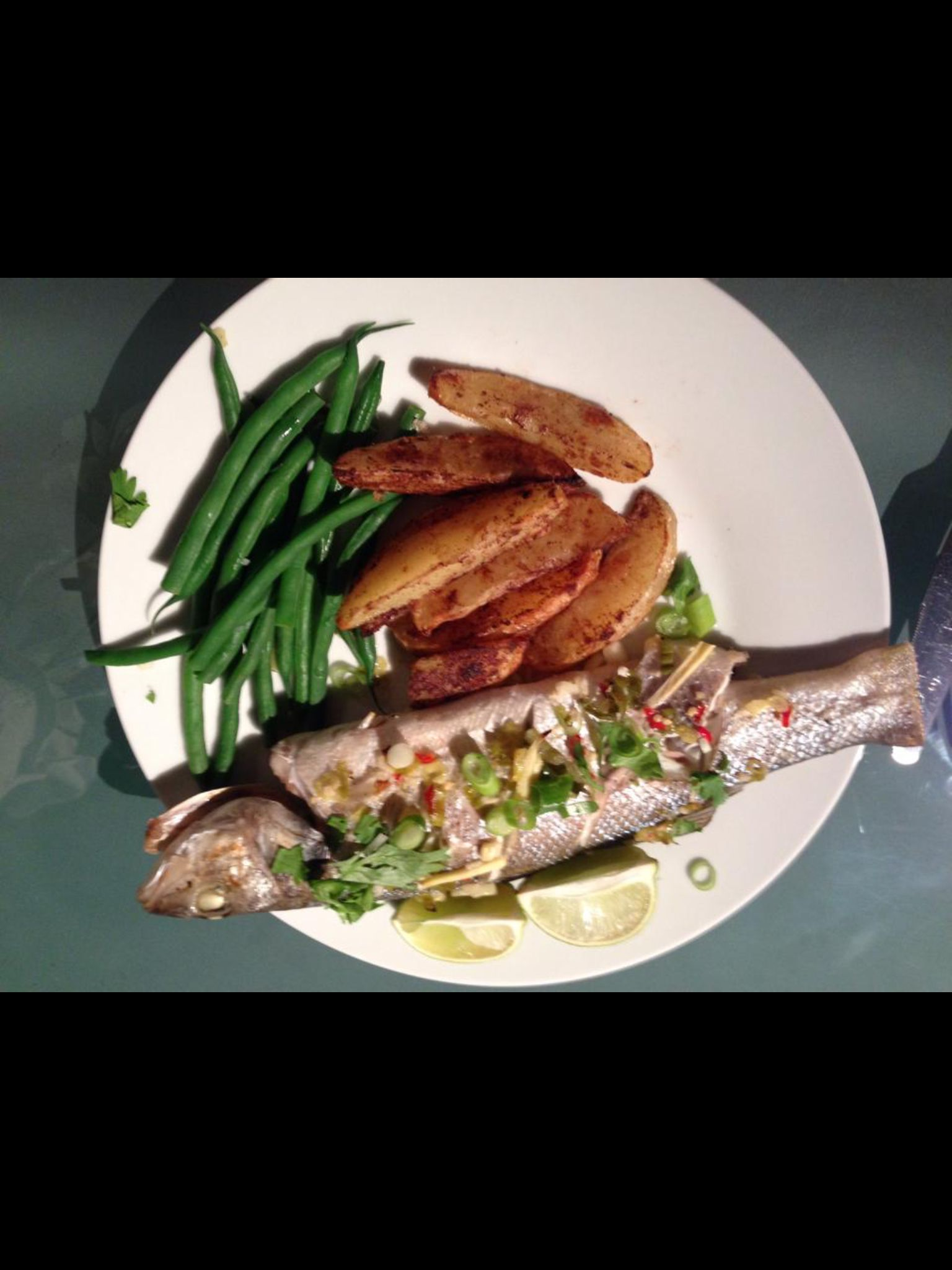 Roasted sea bass with green beans and Chinese five spice wedges.