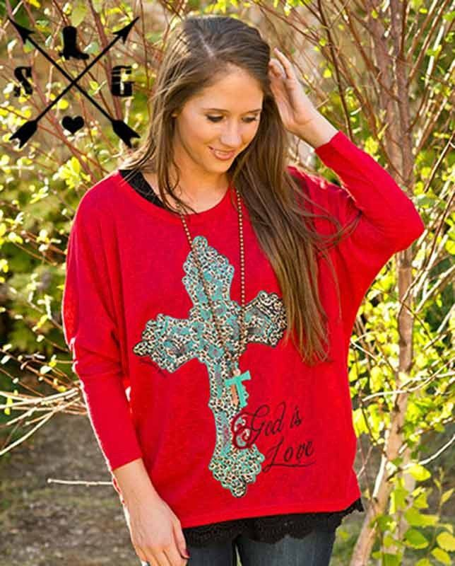 Red God is Love Loose Fitting  Long Sleeve Tee with Cross - a bright red, loose fitting, long sleeve tee. Its over-size look is both trendy and fun. It features a large turquoise cross on the front with brown and black decorative accents. The words GOD IS LOVE appear as if hand-written in black cursive writing across the bottom left of the tee.  | Country Chic casual fashion accessories for women Casual Outfits western wear drysdales.com #countryoutfit #countrygirl #CountryFashion gift…