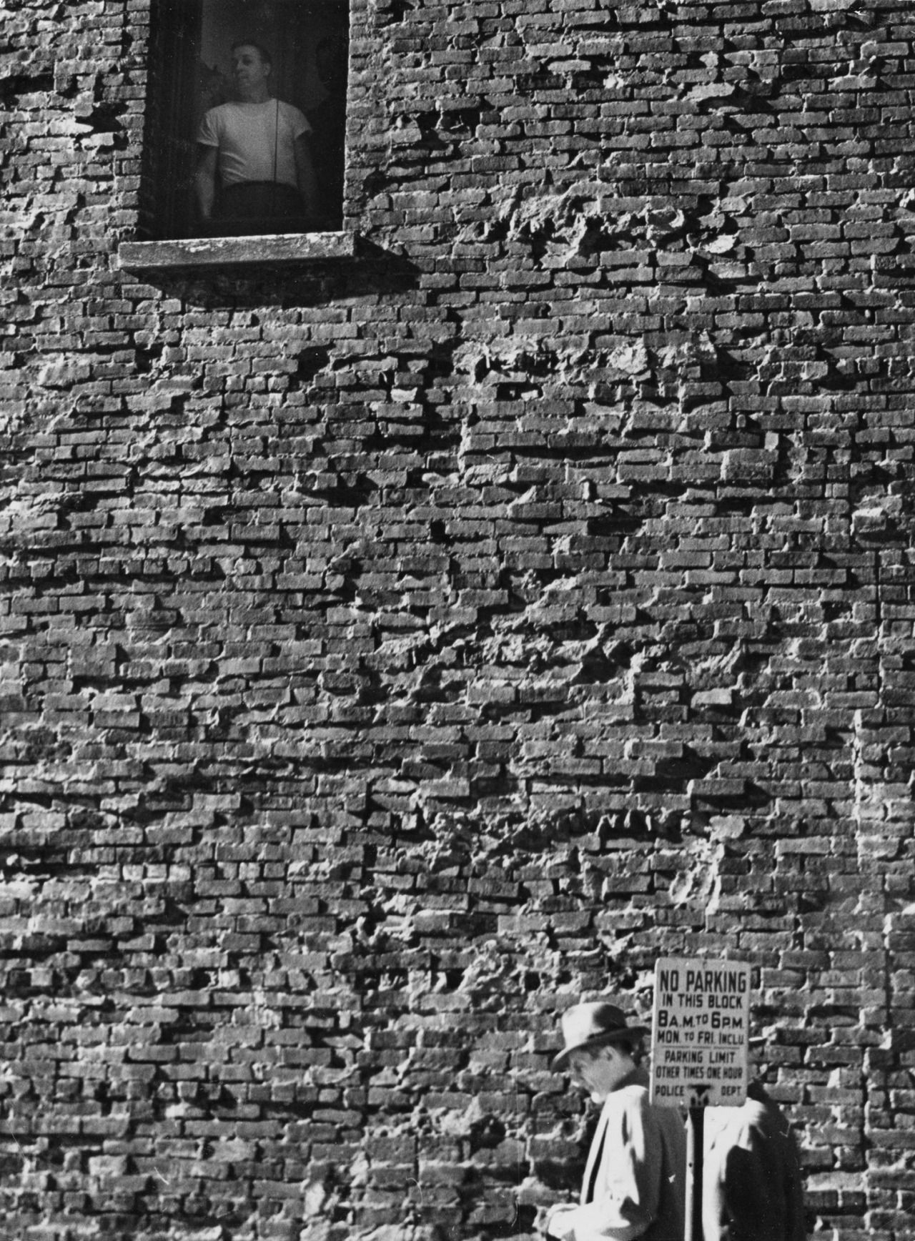From his window perch andre kertesz captured candid moments where his subjects were unaware the master photographer was watching them