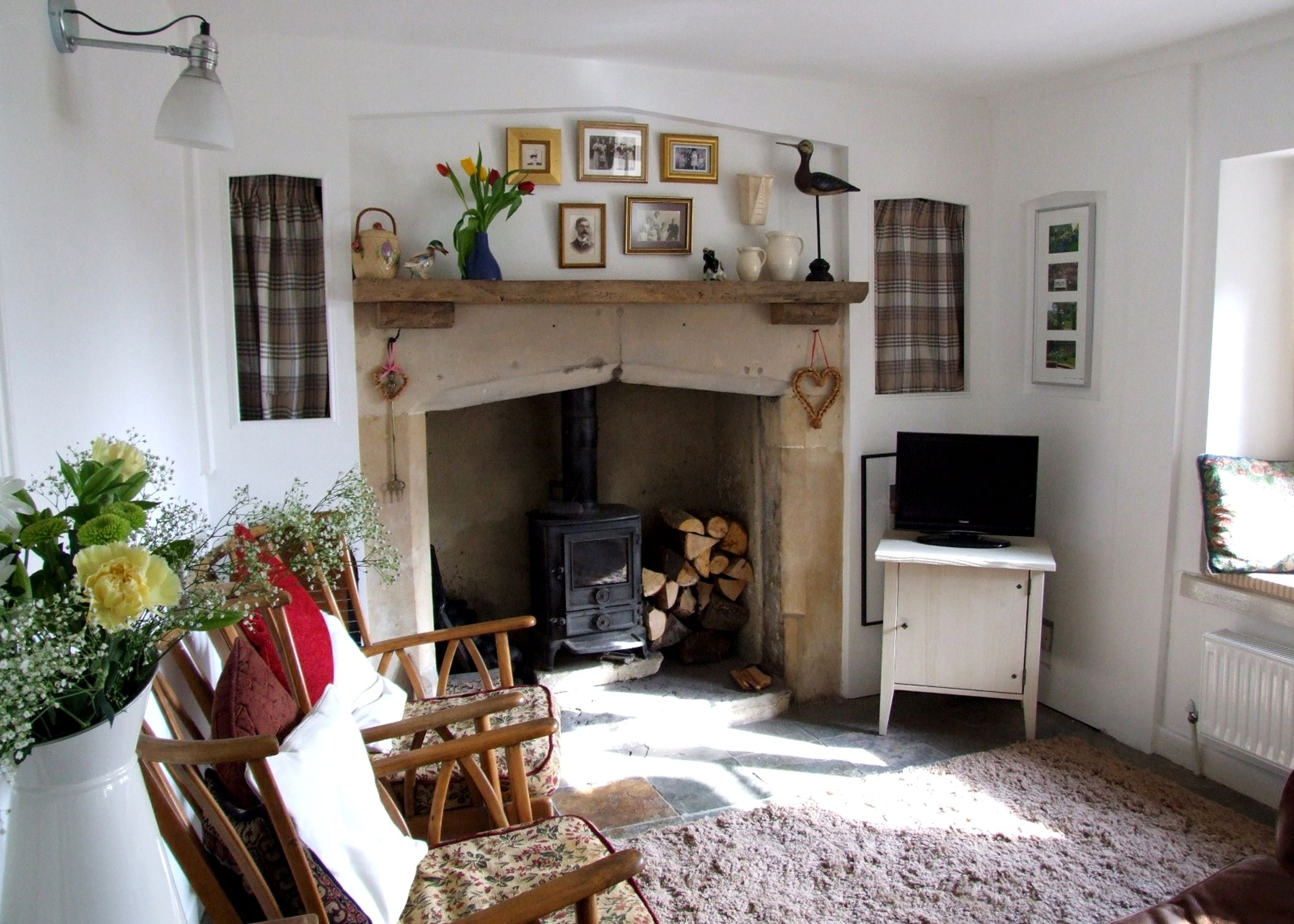 church cottage living room with original stone fireplace and wood