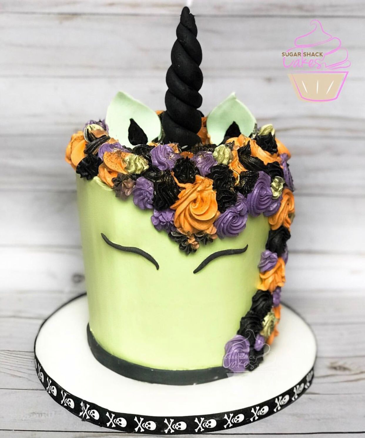 Unicorn cake rainbow. Halloween Unicorn. Orange, purple