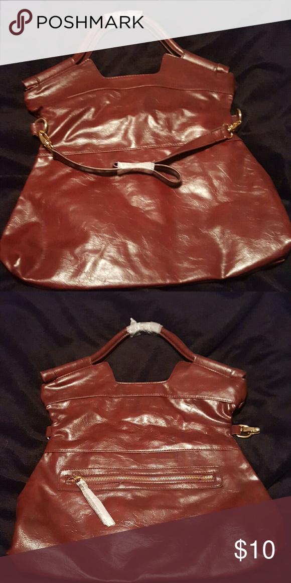 Dark chestnut  bag Never used bag rich chestnut color detachable strap13 long by 13 high can fold over Bags Shoulder Bags