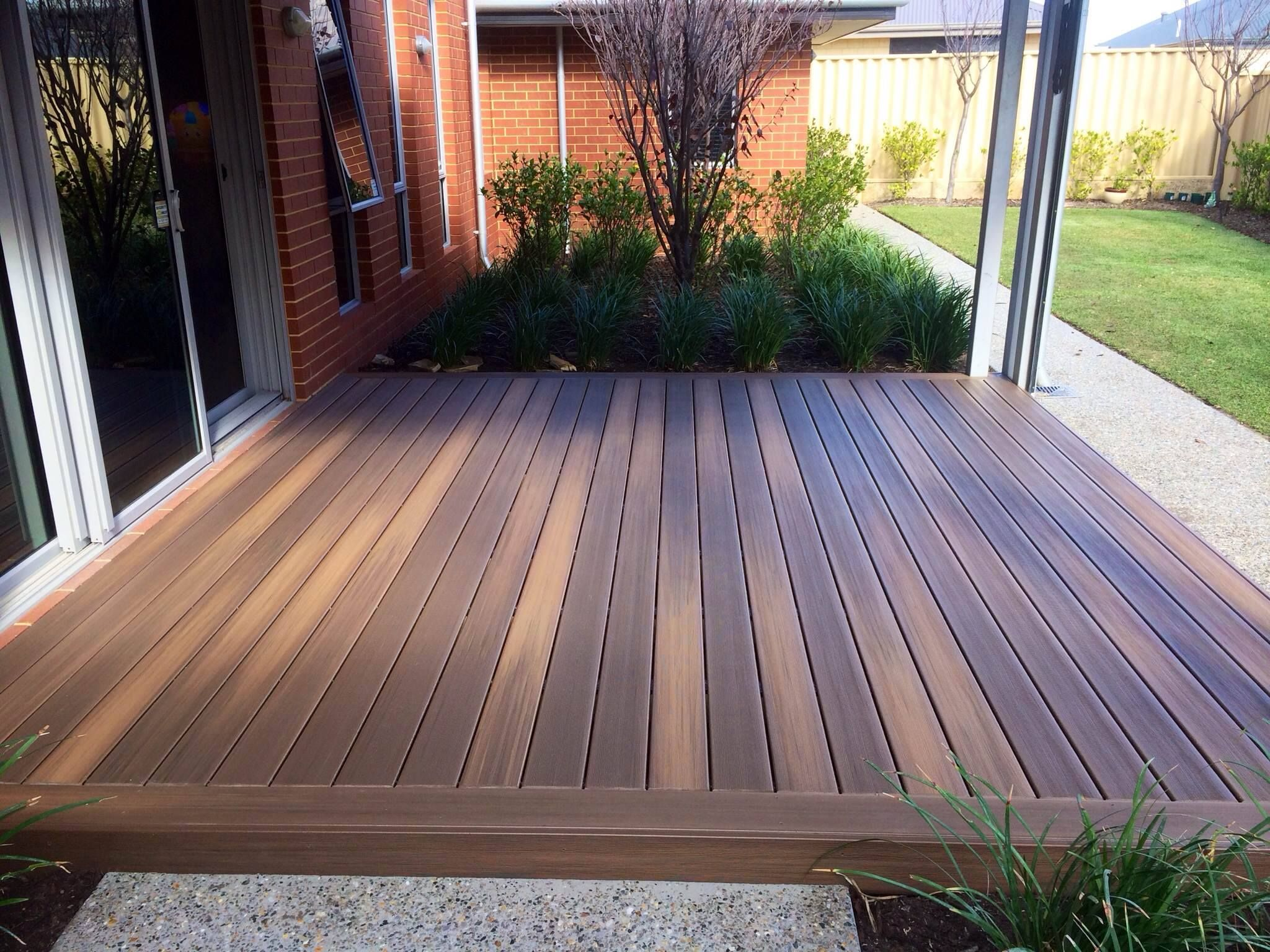 Duralife tropical walnut capped composite decking for Who makes tropics decking