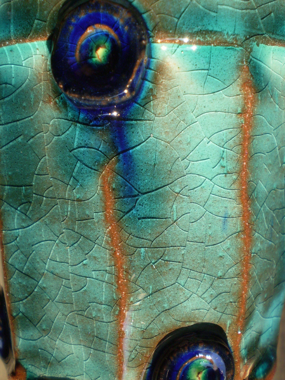 Deatail of a turquoise eartheware beaker. Made by Pim van Huisseling ...