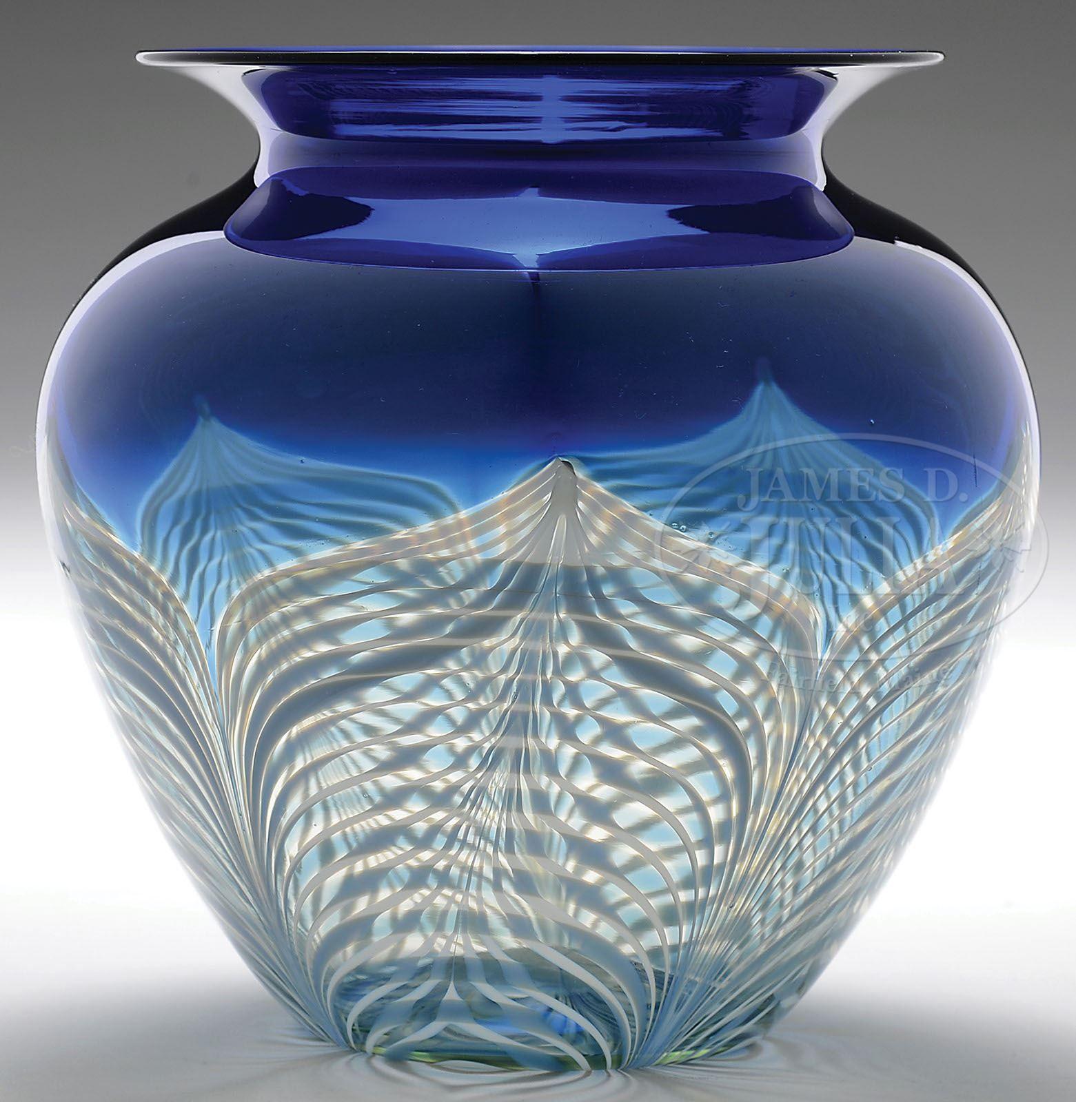 James D. Julia, Inc. - Durand Shoulder Vase. Cobalt blue vase with a white pulled feather decoration.