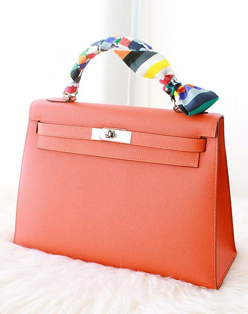 Coral colour Hermes kelly bag and silk Twilly.  b08b77557283a