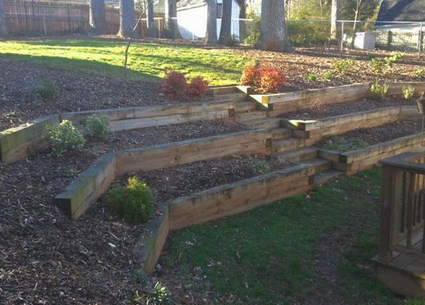 Backyard landscaping effect with tiered railroad tie for Tiered garden designs