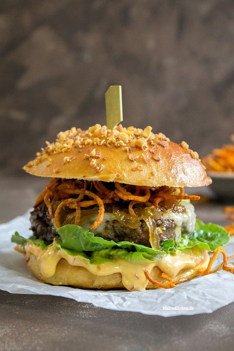 Beef burger with chilli mayo and sweet potato curls  Beef burger in brioche bun with chilli mayo