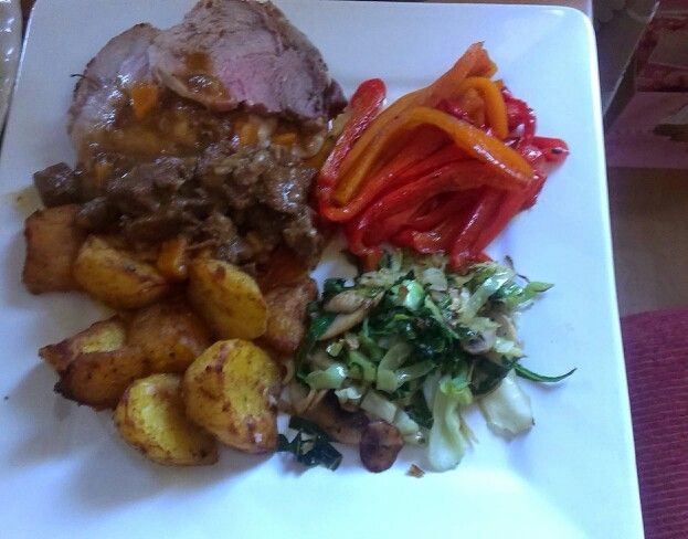 Sunday lunch:                  Roast pork, honey glazed carrot and sweet pepper, roasted sweet potatoes, cabbage and mushroom stir-fry with a beef stew gravy.