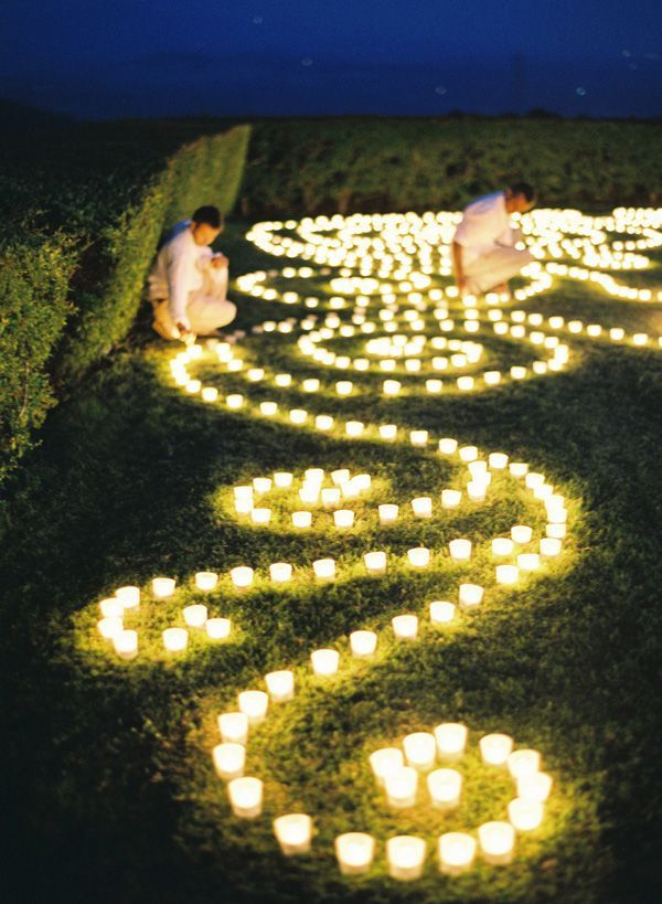 glowing votives in a gorgeous patttern. Night patio garden wedding decoration