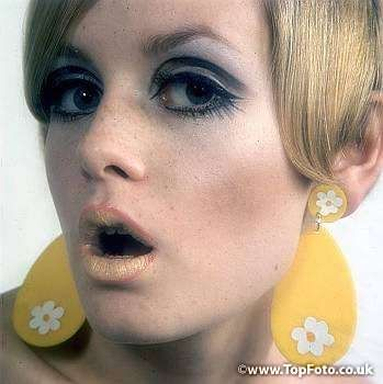 Model Twiggy very 1960s look with the hair make up and earrings