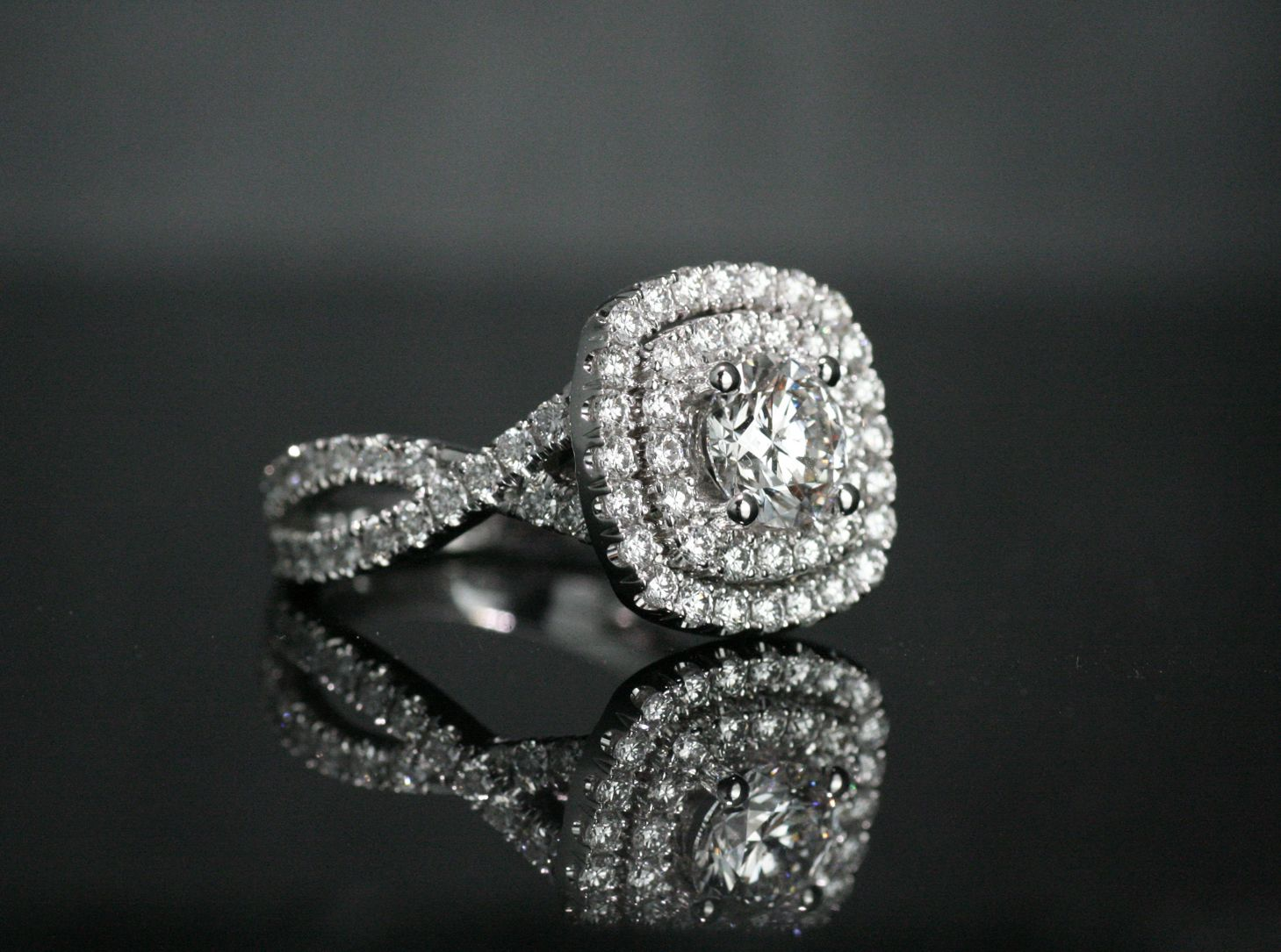 Double halo design with crisscross diamond band set in