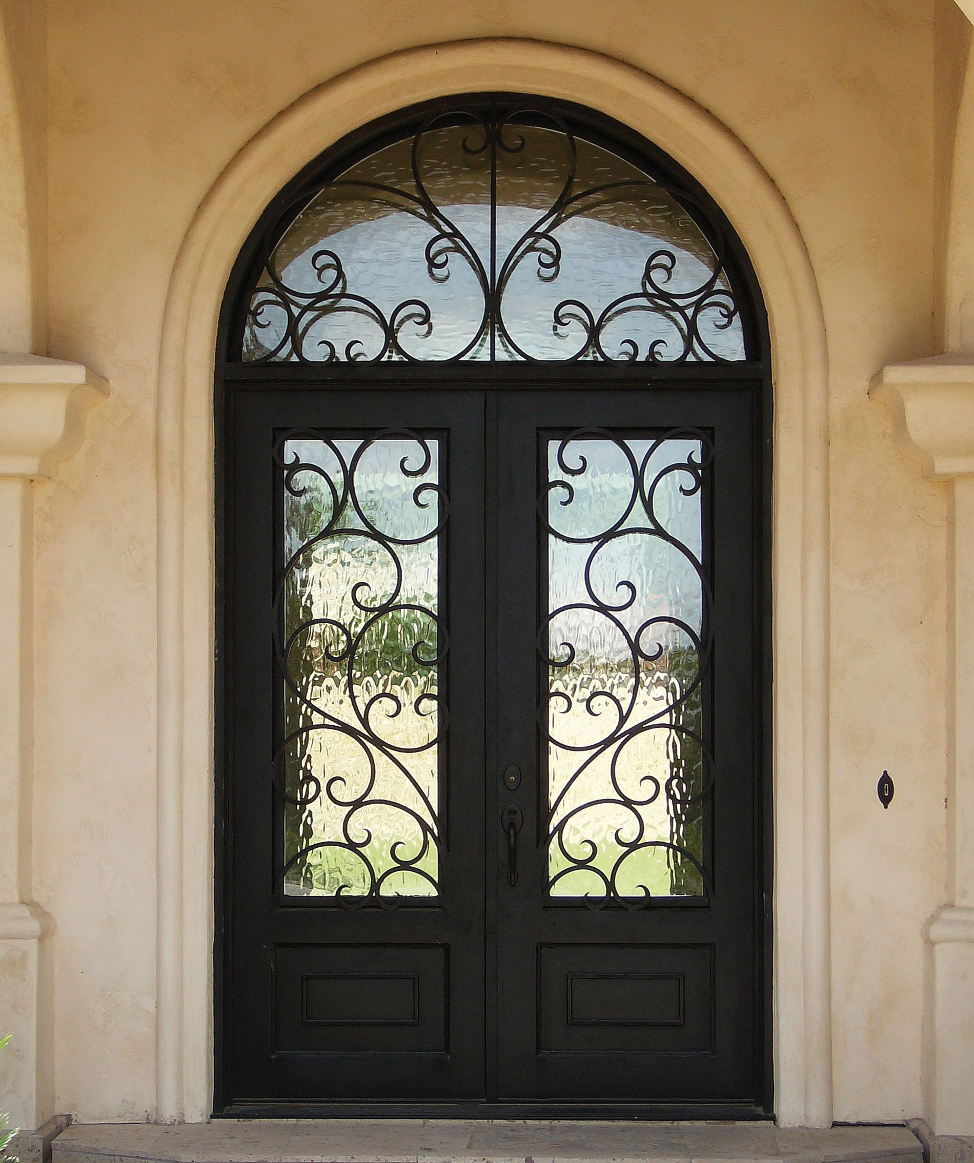 Double Durango Door - flemish glass with scrolls. Prefer the light style with an eyebrow top. Not sure if we need the transom on top or not. & Elegance | No Place Like Home- Doors | Pinterest | Doors pezcame.com