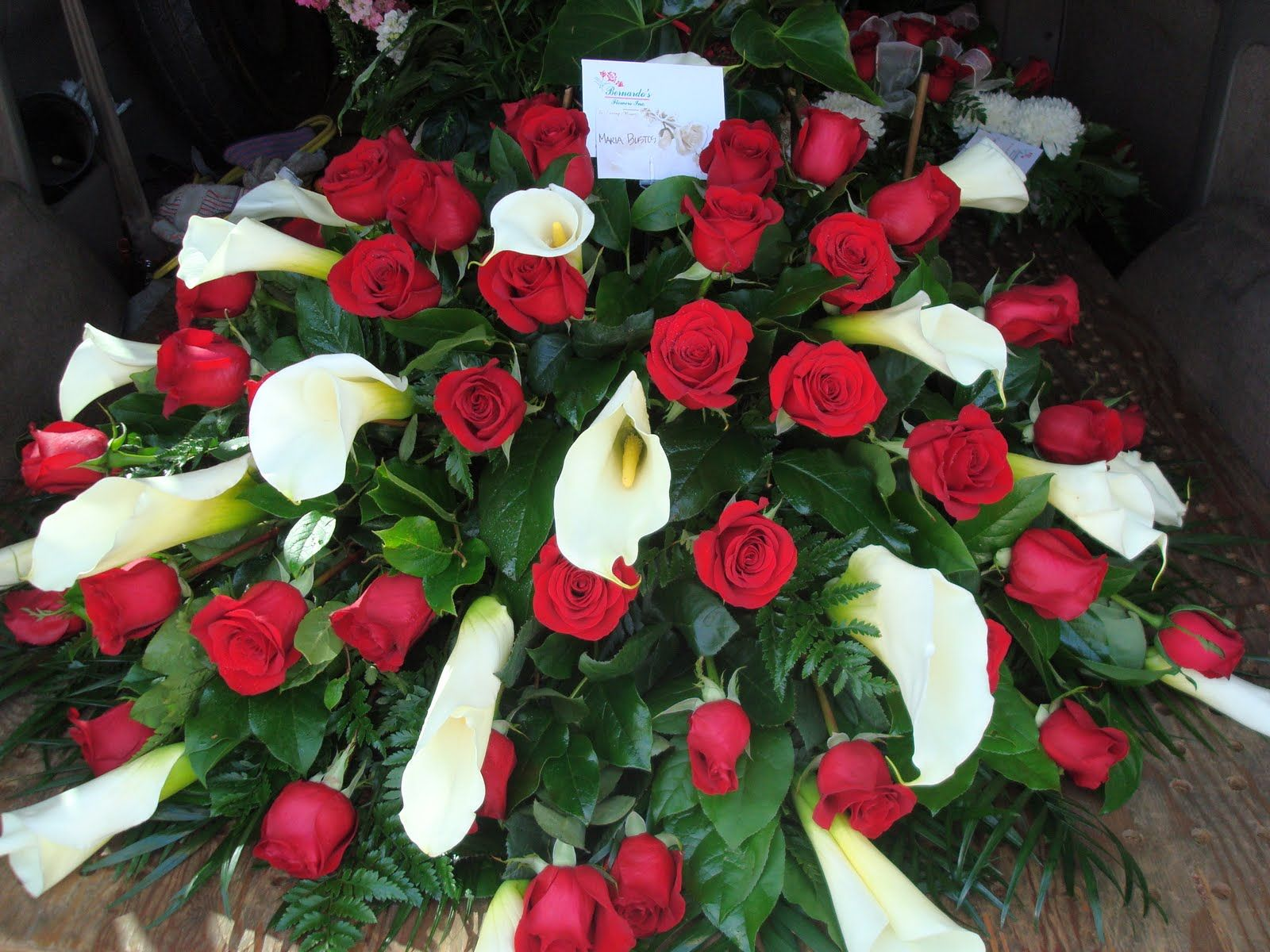 Calla lilies with red roses casket piece funeral flowers calla lilies with red roses casket piece funeral flowerscalla izmirmasajfo Image collections