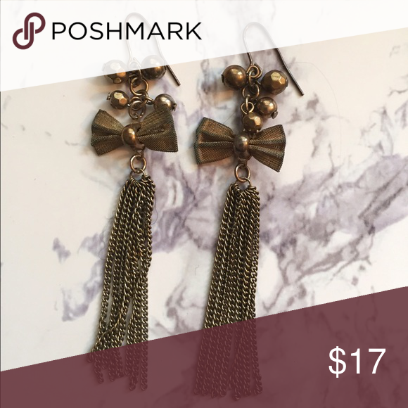 Dark gold bow earrings with fringe These earrings are super cute and in great condition! They are light weight and a gold color. Jewelry Earrings