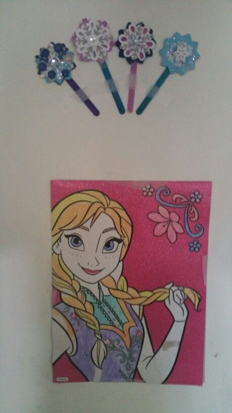 Colored frozen pic and painted snow flakes and colored popsicle sticks