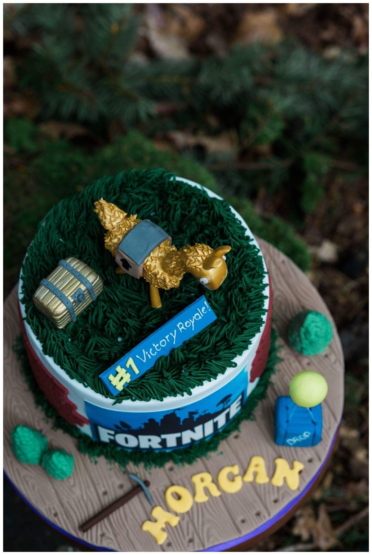 Fortnite birthday cake with victory royals sign and llama