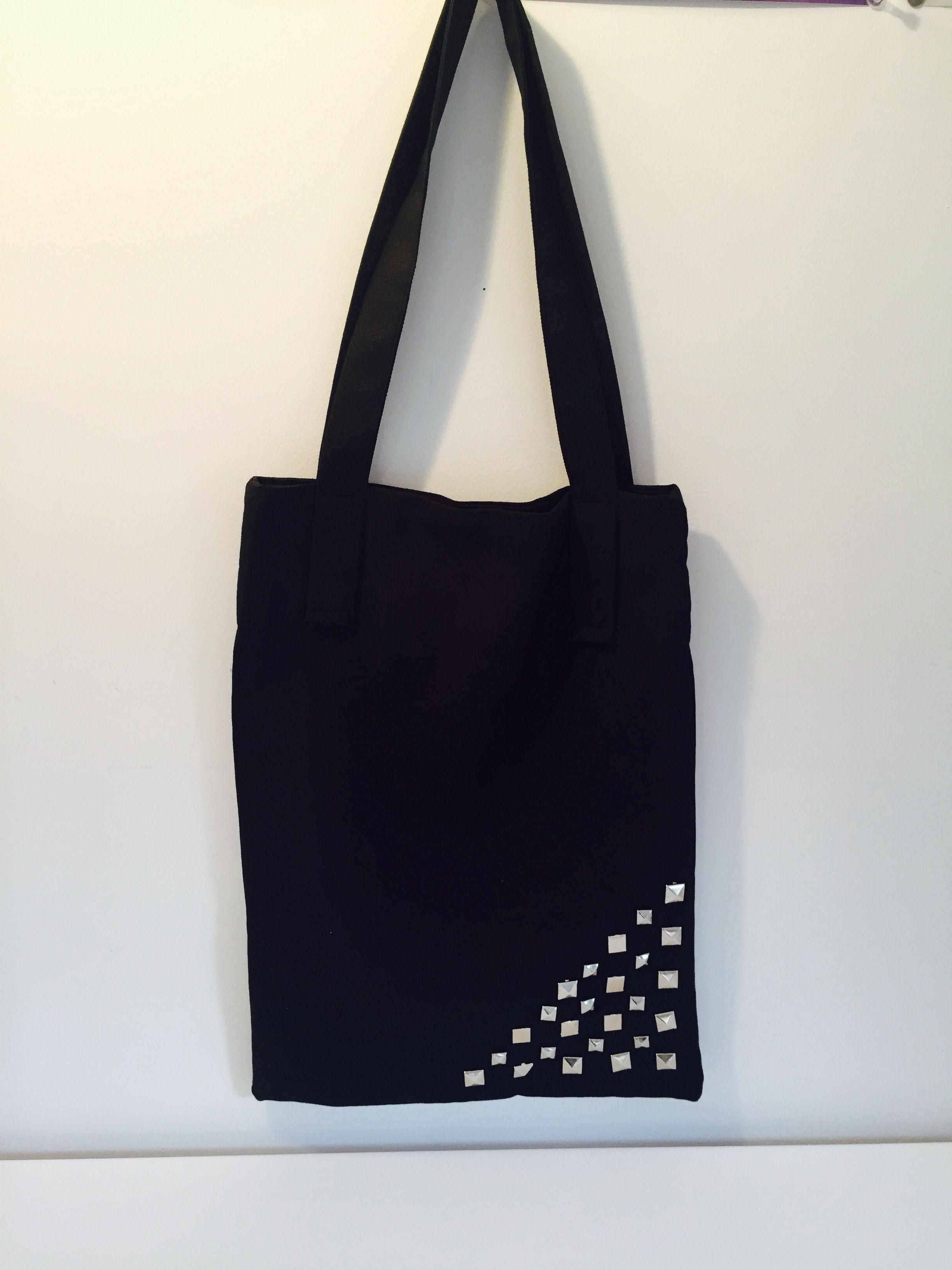 Black studded tote bag