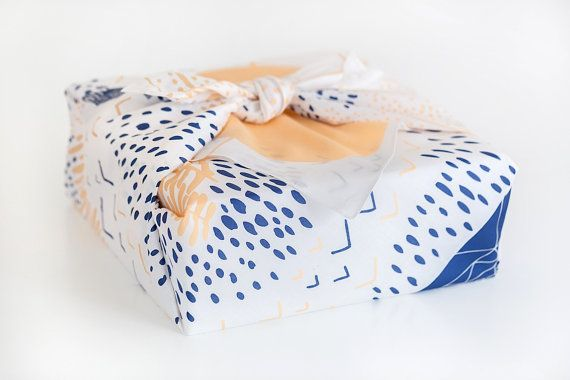 I love this idea of wrapping a gift box with a pretty scarf via Ampersand Design Studio! Scarf via Leah Duncan.