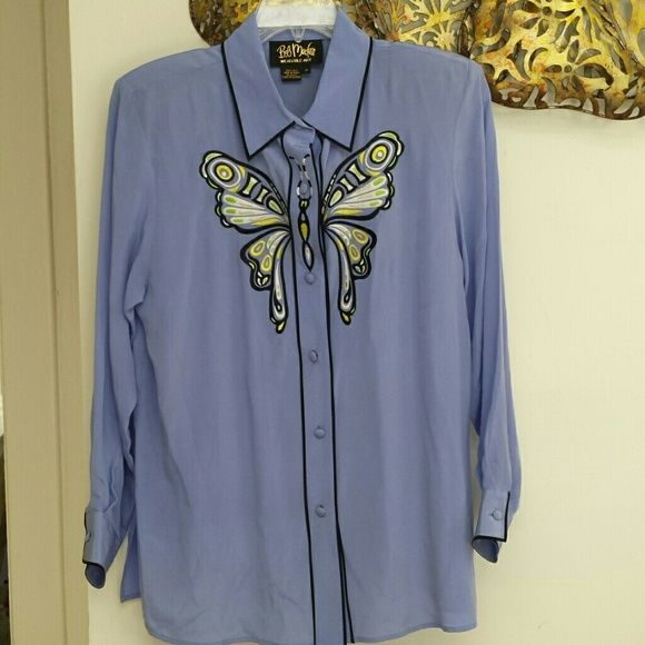 """Bob Mackie silk butterfly blouse Beautiful vintage lavender button up blouse. 100% silk.  Black trim. Embroidered butterfly on front. Removable shoulder pads. No major flaws, could probably use a dry cleaning. Size medium. Bob Mackie Wearable Art. Appx measurements laid flat: armpit to armpit 20"""", length shoulder to hem in front 30.5"""". Bob Mackie Tops Button Down Shirts"""