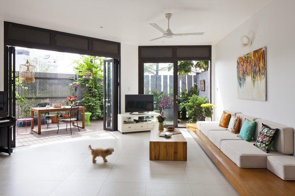 Modern Family Home Adapted To A Tropical Environment In Vietnam Freshome Com Living Room Inspiration House Interior Living Room Modern