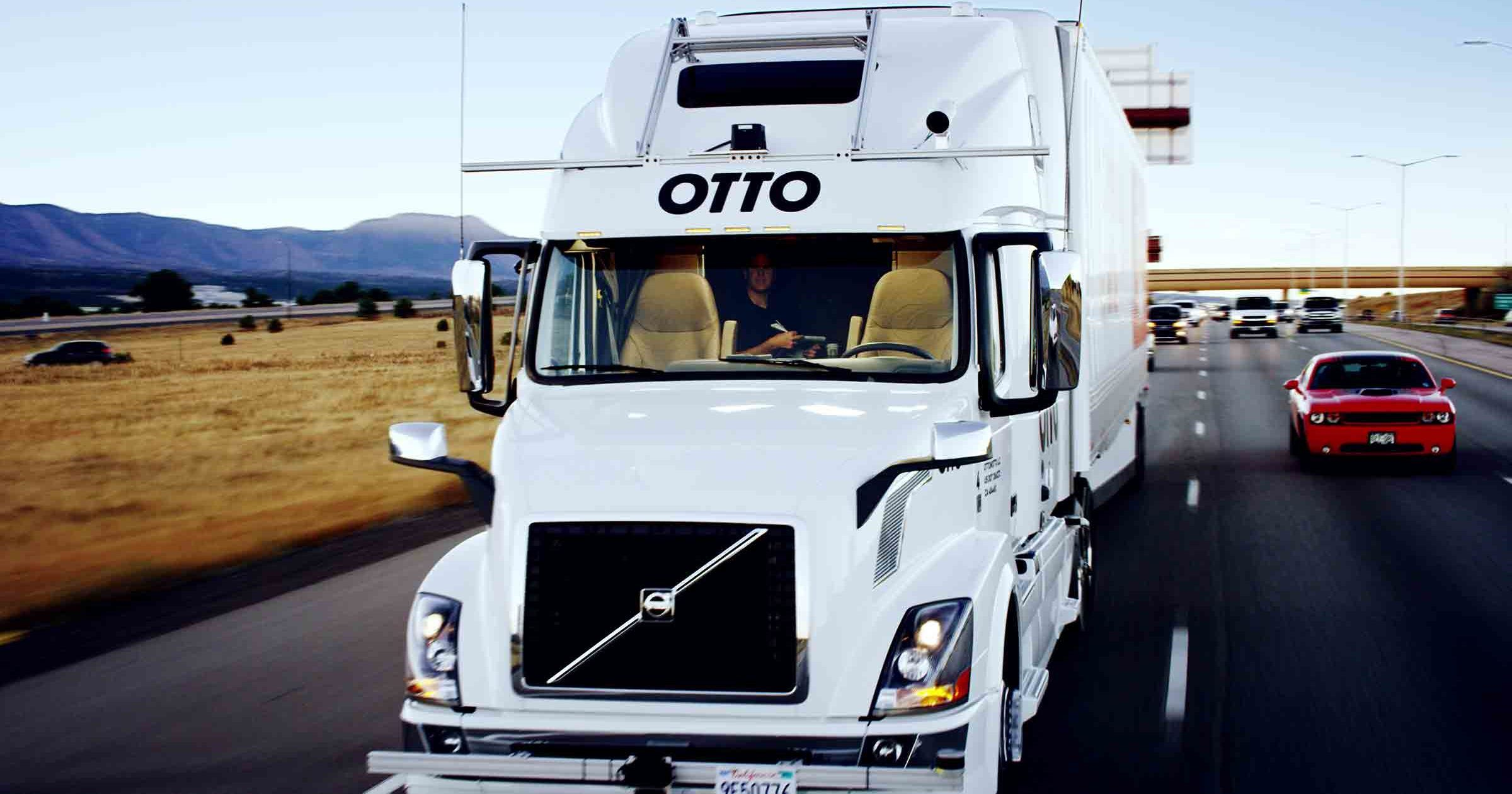 truck on autonomous mode and driver practising yoga ubers self driven truck makes its first delivery