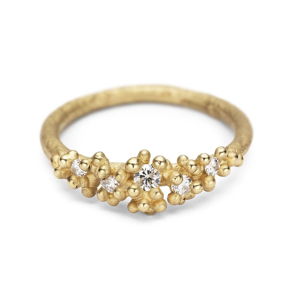 A unique white diamond and yellow gold engagement ring from our alternative engagement ring collection, handmade in London.