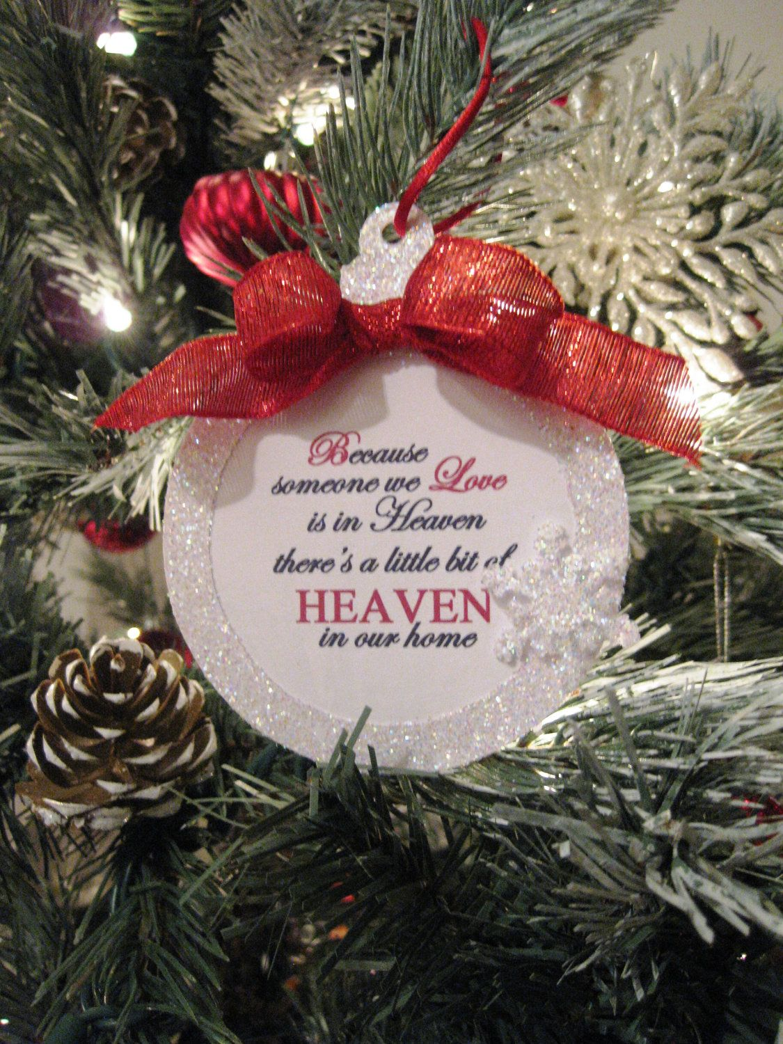 Because Someone We Love Is In Heaven - Christmas Ornament Red Ribbon. $8.95, via Etsy.