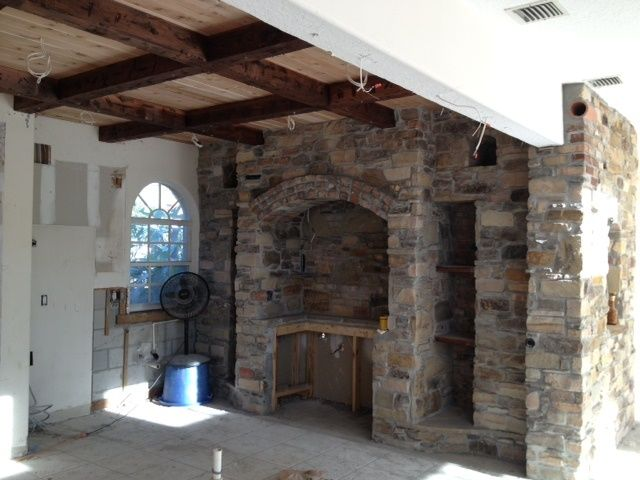Tuscan kitchen stone and cedar beam ceiling | Living room ...