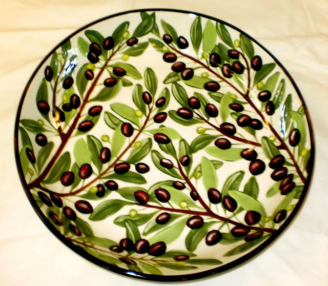 Large olive pasta bowl, a current pattern painted by Geoff Graham in Vallejo, California at Cinnabar Ceramics. You can google the Cinnabar Ceramics Website if you want to know more.
