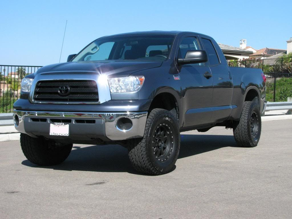 Pictures show and tell your lifted or leveled tundra
