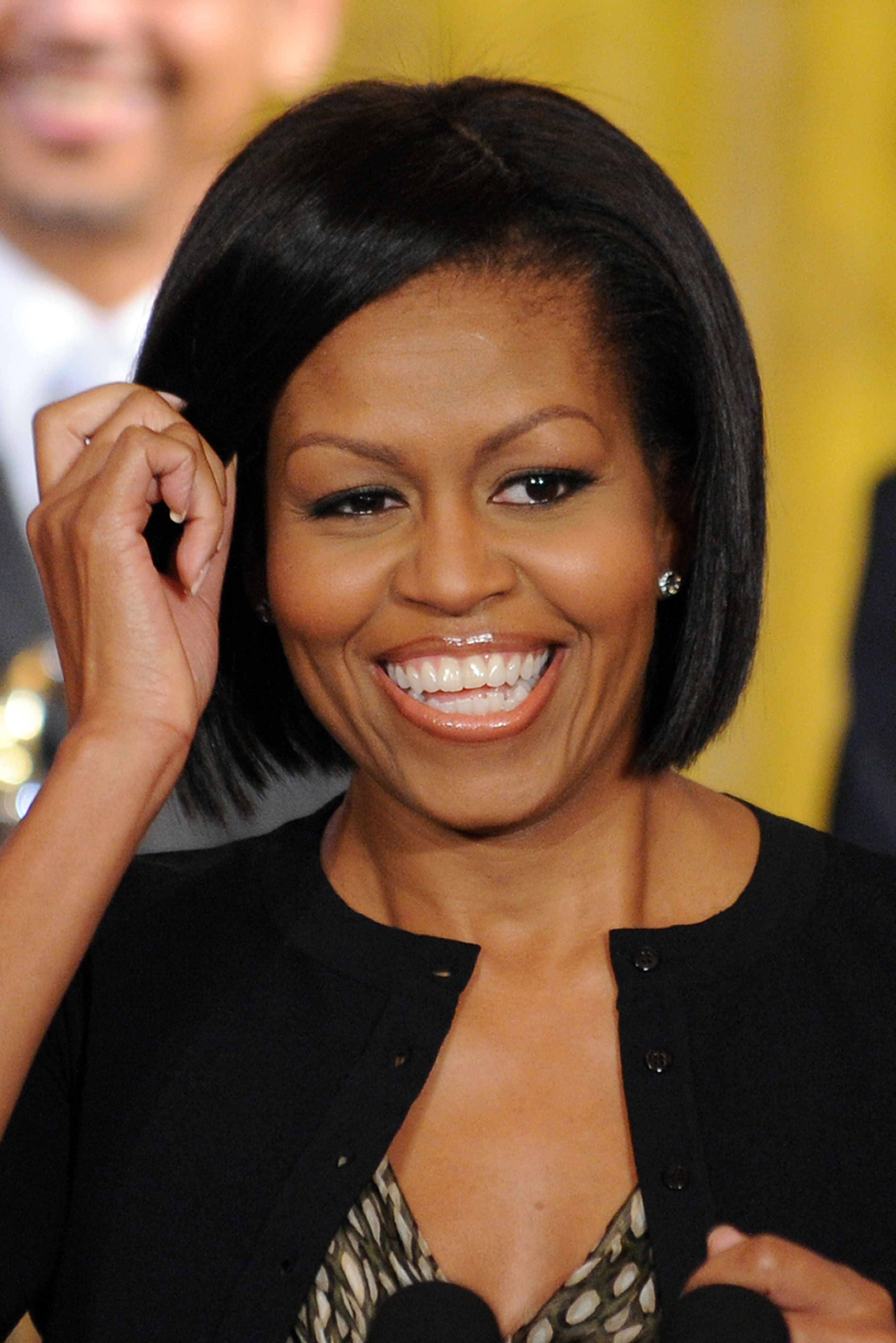 A Look Back At All Of Michelle Obama S Best Hair Moments In The White House Michelle Obama Hairstyles Michelle Obama Cool Hairstyles