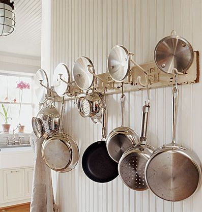 This Kitchen Pot Rack Started Life As A Coat Hanger. Rather Than Throw It  In A Landfill, It Got A Second Chance As A Kitchen Gizmo.