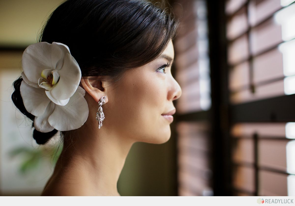 the bride. love the orchid hair adornment. #wedding | kelsey and