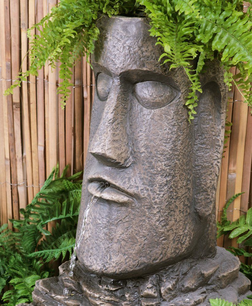 une jolie fontaine solaire pour jardin zen en extérieur