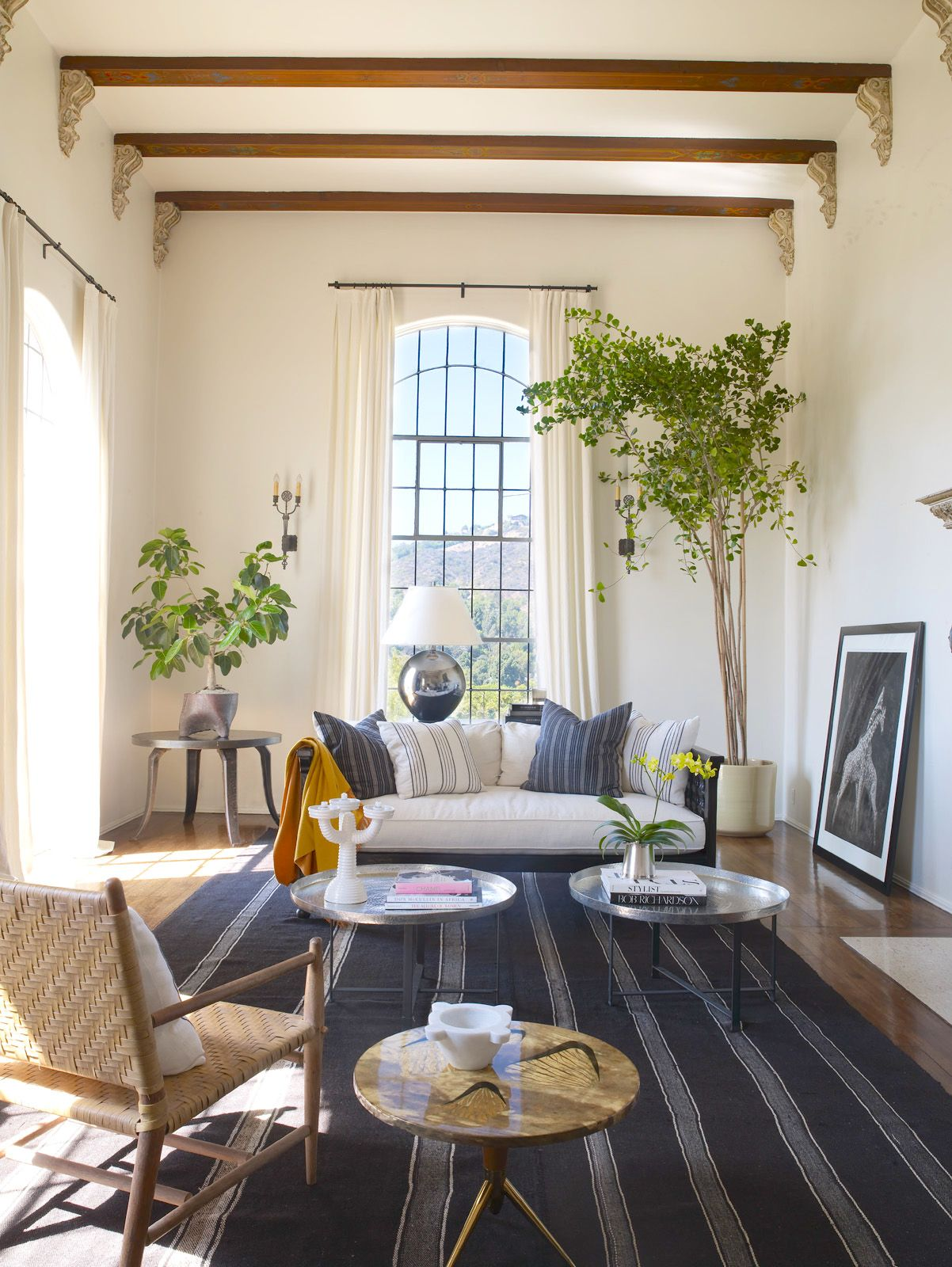 spanish colonial tall window treatments indoor trees and tall windows