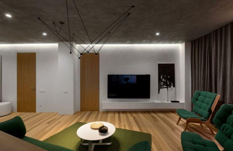 farbe-grün-deko-teppich-khaki-wohnwand-schlicht-lowboard - wohnideen wohnzimmer grun