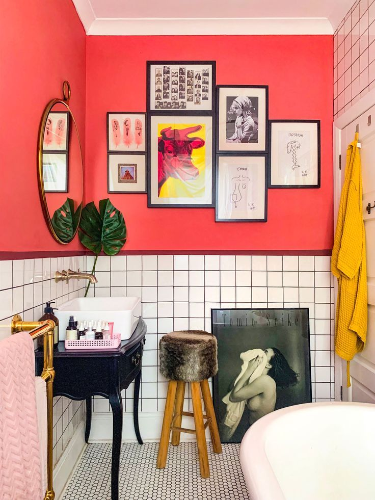 Bright pink bathroom with red accent stripe. Vintage dresser sink, roll top bath, gold towel rail and roll top bath. #HouseBathroomIdeas